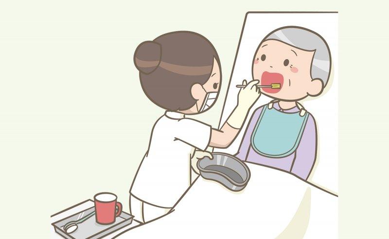 口腔ケアをおこなう病棟看護師のイラスト
