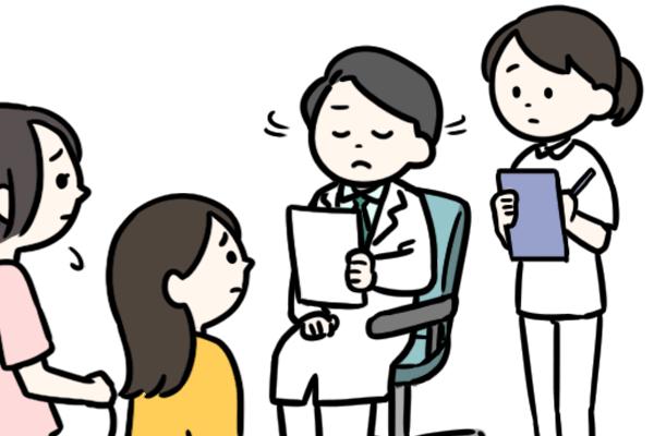 患者の女性カップルを前に首を横にふる医師と看護師のイラスト