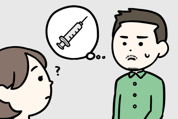ホルモン療法について看護師に話す必要があるか迷っているトランス男性の患者のイラスト