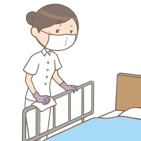 看護師がベッドの柵を拭いているイラスト