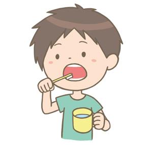 歯を磨いている小学生の男の子(男子)のイラストです。