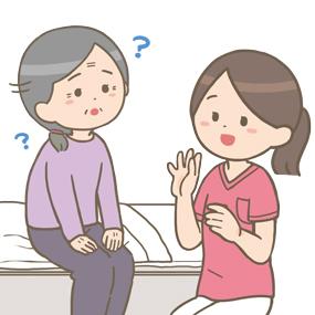 訪問看護師さんが認知症の高齢者の方とコミュニケーションをとっているイラストです。