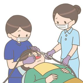 歯科医師と歯科衛生士が歯科治療をしているイラスト
