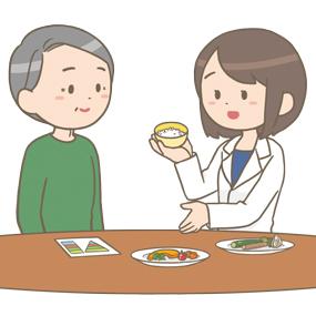 管理栄養士さんが糖尿病患者さんへの食事指導をしているイラストです。 野菜やお米を見せながら説明をしています。