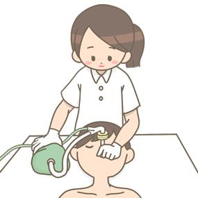 気管内挿管中の患者さんにジャクソンリースを使用している看護師さんのイラストです。