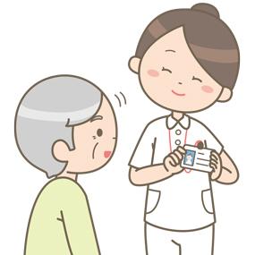 看護師が患者さんに自分の名札を見せているイラスト