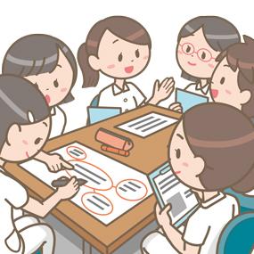 研修のグループワークで男女の看護師が話し合いをしているイラストです。