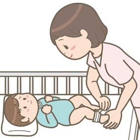 看護師が患児の足首にネームバンドをつけているイラスト