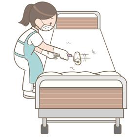 ベッドに粘着カーペットクリーナーをかける看護師のイラスト