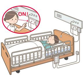 センサーマットのスイッチが入っていることを確認する看護師のイラスト