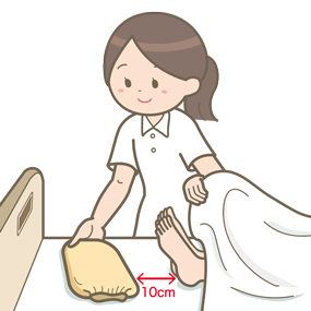 温罨法をする看護師のイラスト