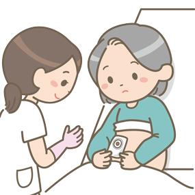 ストーマの貼付を指導している看護師のイラスト