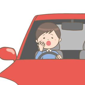 あくびをしながら運転をする男性のイラスト