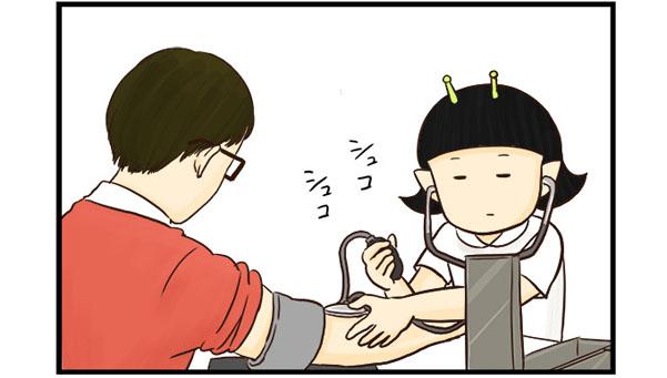 血圧を測る看護師よし子